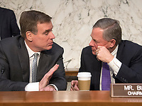 United States Senator Mark Warner (Democrat of Virginia), Vice Chairman, left, and US Senator Richard Burr (Republican of North Carolina), Chairman, right, of the US Senate Committee on Intelligence, discuss the day's testimony before the United States Senate Committee on Intelligence during a hearing to examine worldwide threats on Capitol Hill in Washington, DC on Tuesday, February 13, 2018<br /> Credit: Ron Sachs / CNP /MediaPunch