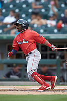 Rusney Castillo (38) of the Pawtucket Red Sox follows through on his swing against the Charlotte Knights at BB&T BallPark on July 19, 2018 in Charlotte, North Carolina. The Knights defeated the Red Sox 4-3.  (Brian Westerholt/Four Seam Images)