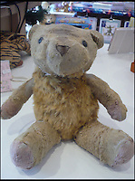 BNPS.co.uk (01202 558833)<br /> Pic: AlicesBearShop/BNPS<br /> <br /> Teddy, Napier, after the surgery.<br /> <br /> Broken bears and deteriorating dolls from all over the world are being brought back to life by a UK team of dedicated doctors and nurses at one of the last remaining toy hospitals.<br /> <br /> The team at Alice's Bear Shop, a teddy bear and doll hospital in Lyme Regis, Dorset, perform all kinds of 'surgery' from simple restringing and re-stuffing to head re-attachments and complete skin grafts.<br /> <br /> Rikey Austin, 49, opened the hospital in January 2000 but also ran a shop and only repaired one or two toys a month.<br /> <br /> Now she has a four-month waiting list for patients and has had to close the shop to focus on the hospital side of the business.