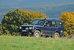 1990s Land Rover Discovery 1, fitted with a raised air intake, on a forest track in the hilly Weserbergland. Seen at an off-road event of the German Land Rover Club held at the Freizeitpark Mammut in Stadtoldendorf, Germany, October 3.-5. 2008. --- No releases available. Automotive trademarks are the property of the trademark holder, authorization may be needed for some uses.