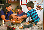 mother baking cookies with children in kitchen