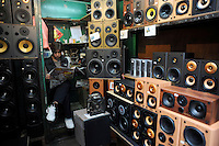 A shop sells hi-fi amplifiers on Apliu Steet in Sham Shui Po district, Hong Kong. Apliu Street is famous for its electronics and accessories stalls. The vendors in this open-air street market sells a wide variety of products at reasonable prices, allowing individuals to trade second hand goods here. .