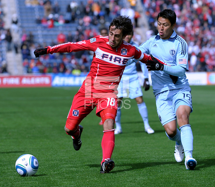 Sporting KC defender Roger Espinoza (15) pressures Chicago Fire forward Gaston Puerari (18).  The Chicago Fire defeated Sporting KC 3-2 at Toyota Park in Bridgeview, IL on March 27, 2011.