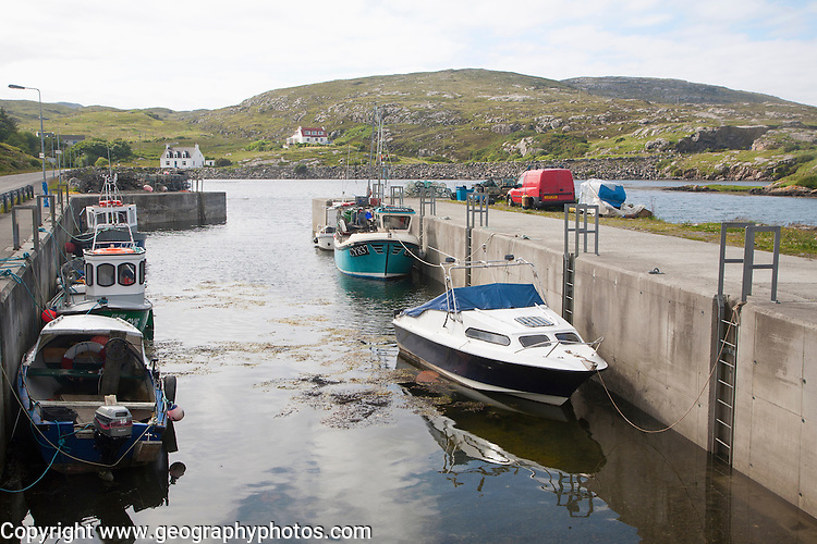 Small fishing boats in harbour at Northbay, Barra, Outer Hebrides, Scotland, UK