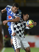 BOGOTÁ -COLOMBIA, 02-08-2014. Oswaldo Henriquez (Izq.) jugador de Millonarios disputa el balón con Juan Perez (Der.) jugador de Boyacá Chicó FC durante partido por la fecha 3 de la Liga Postobón II 2014 jugado en el estadio Nemesio Camacho el Campín de la ciudad de Bogotá./ Oswaldo Henriquez (L) player of Millonarios fights for the ball with Juan Perez (R) player of Boyaca Chico FC during the match for the third date of the Postobon League II 2014 played at Nemesio Camacho El Campin stadium in Bogotá city. Photo: VizzorImage/ Gabriel Aponte / Staff