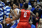 15 November 2014: Duke's Jahlil Okafor (left) and Fairfield's Mike Kirkland. The Duke University Blue Devils hosted the Fairfield University Stags at Cameron Indoor Stadium in Durham, North Carolina in an NCAA Men's Basketball exhibition game. Duke won the game 109-59.