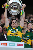 Paul Geaney lift the Sam Maguire Cup to celebrate  Kerry's victory over Donegal in the All-Ireland Football Final against  in Croke Park 2014.<br /> Photo: Don MacMonagle<br /> <br /> <br /> Photo: Don MacMonagle <br /> e: info@macmonagle.com