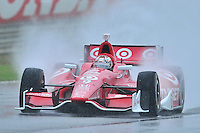 Scott Dixon, of New Zealand, negotiates a rainy straight during an IZOD Indycar Series practice session Friday afternoon at Barber Motorsports Park in Birmingham, Alabama.