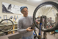 NWA Democrat-Gazette/BEN GOFF @NWABENGOFF<br /> Steve Marquess, a volunteer from Bentonville, trues a bicycle wheel Tuesday, Dec. 26, 2017, at Pedal it Forward NWA in Bentonville.