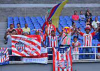 PEREIRA -COLOMBIA-02-08-2014. Aspecto de los hinchas del Junior durante el encuentro entre Aguilas Doradas y Atletico Junior en partido por la fecha 3 de la Liga Postobón II 2014 jugado en el estadio Hernán Ramírez Villegas de Pereira./ Aspect of the Junior's followers during the match between Aguilas Doradas and Atletico Junior for the third date of the Postobon Cup 2014 played at Hernan Ramirez Villegas of Pereira city.  Photo:VizzorImage/ CONT