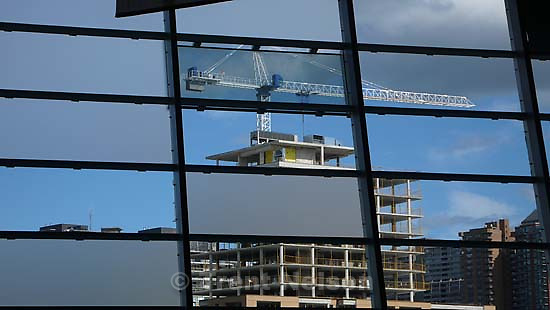 Looking out from canadian war museum toward construction and crane