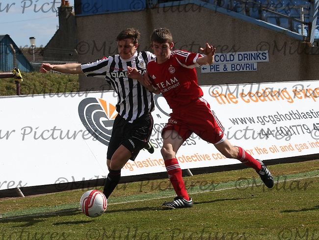 Ross Meechan being edged out by Kieran Gibbons in the Aberdeen v St Mirren Clydesdale Bank Scottish Premier League Under 20 match played at Balmoor Stadium, Peterhead on 19.4.13.