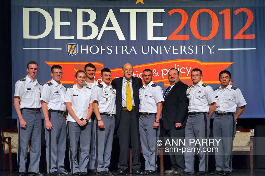 """Oct. 15, 2012 - Hempstead, New York, U.S. - Former Senator ALAN SIMPSON (Republican) is standing at center with West Point cadets who were in the audience when he spoke at Hofstra University about ?America's Debt and Deficit Crisis: Issues and Solutions.? Simpson is co-chairman of the National Commission on Fiscal Responsibility and Reform and co-leader of the Simpson-Bowles non-partisan U.S. fiscal debt reduction plan. This was part of """"Debate 2012 Pride Politics and Policy"""" a series of events leading up to when Hofstra hosts the 2nd Presidential Debate between Obama and M. Romney, the next night, October 16, 2012, in a Town Meeting format."""