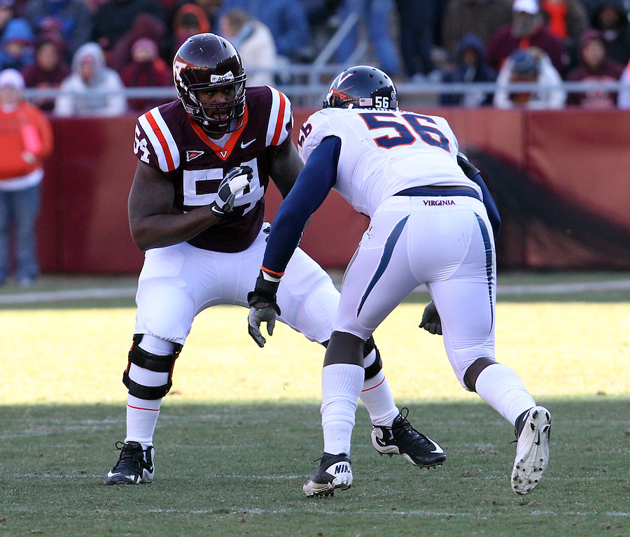 Nov 27, 2010; Charlottesville, VA, USA;  Virginia Tech Hokies offensive tackle Nick Becton (54) and Virginia Cavaliers defensive end Cam Johnson (56) during the game at Lane Stadium. Virginia Tech won 37-7. Mandatory Credit: Andrew Shurtleff