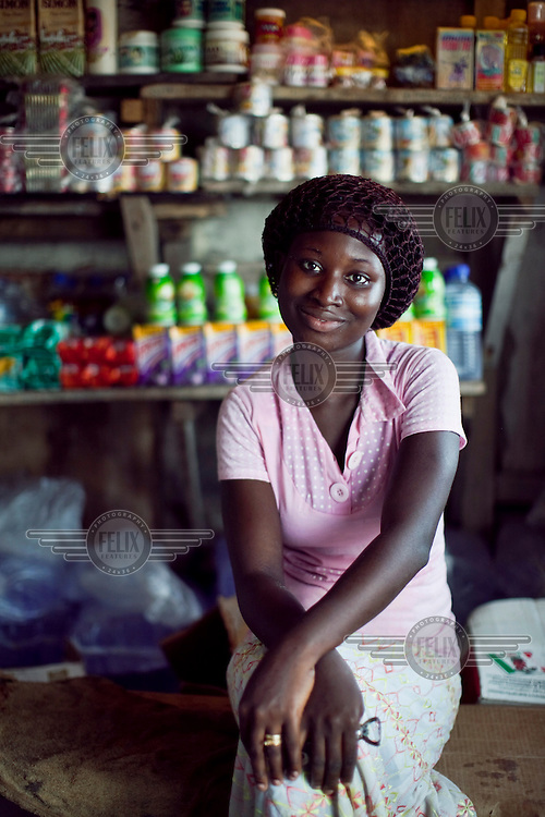 Esther Ogunleke at a local store on Kuramo Beach. Like millions of Lagos residents, Esther lives in a makeshift shack on land that she does not own.
