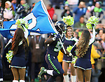 Seattle Seahawks linebacker Kevin Pierre-Louis (58) carries the 12th Man flag onto the game during team introductions before kick off against the San Francisco 49ers at CenturyLink Field in Seattle, Washington on November 22, 2015.  The Seahawks beat the 49ers 29-13.   ©2015. Jim Bryant Photo. All RIghts Reserved.