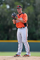 Baltimore Orioles pitcher Dylan Bundy #82 gets ready to deliver a pitch during a minor league spring training game against the Tampa Bay Rays at the Buck O'Neil Complex on March 21, 2012 in Sarasota, Florida.  Bundy, the fourth overall draft pick of the 2011 MLB Draft, went two innings on the mound.  (Mike Janes/Four Seam Images)