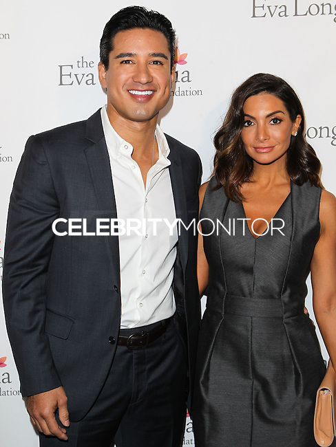 HOLLYWOOD, LOS ANGELES, CA, USA - OCTOBER 09: Mario Lopez, Courtney Laine Mazza arrive at the Eva Longoria Foundation Dinner held at Beso Restaurant on October 9, 2014 in Hollywood, Los Angeles, California, United States. (Photo by Celebrity Monitor)