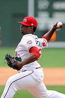Pitcher German Taveras  (38) of the Greenville Drive delivers a pitch in a game against the Asheville Tourists on Sunday, July 20, 2014, at Fluor Field at the West End in Greenville, South Carolina. Asheville won game two of a doubleheader, 3-2. (Tom Priddy/Four Seam Images)