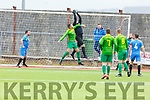 Strand Road's Chris O'Sullivan putting pressure on the  Mitchells Ave keeper  Chris Hegarty in the Denny KDL league in Mounthawk Park on Sunday.