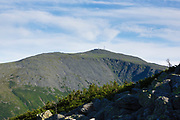 Mount Washington in the Presidential Range from along the Six Husbands Trail in Thompson and Meserve's Purchase, New Hampshire during the summer months. The Great Gulf Wilderness is in the foreground and center. This area is part of the White Mountains.