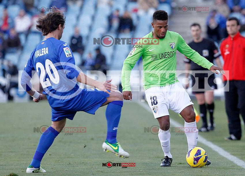 Getafe's Juan Valera (l) and Malaga's Eliseu Pereira during La Liga match.December 01,2012. (ALTERPHOTOS/Acero) ©/NortePhoto