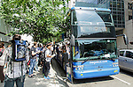Passengers wait to board a Megabus coach stoped on Van Buren street between Canal and Clinton, Friday, June 3, 2016, in downtown Chicago, IL. (DePaul University/Jeff Carrion)