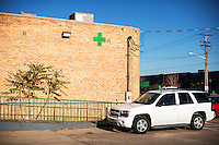 A green cross marks the 3D Medical Marijuana Center grow house and store in Denver, Colorado, Tuesday, November 12, 2013. <br /> <br /> Photo by Matt Nager