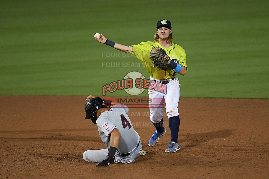 Second baseman Nick Conti (21) of the Columbia Fireflies makes the putout on Pedro Gonzalez (4) of the Hickory Crawdads in a game on Wednesday, August 28, 2019, at Segra Park in Columbia, South Carolina. Hickory won, 7-0. (Tom Priddy/Four Seam Images)