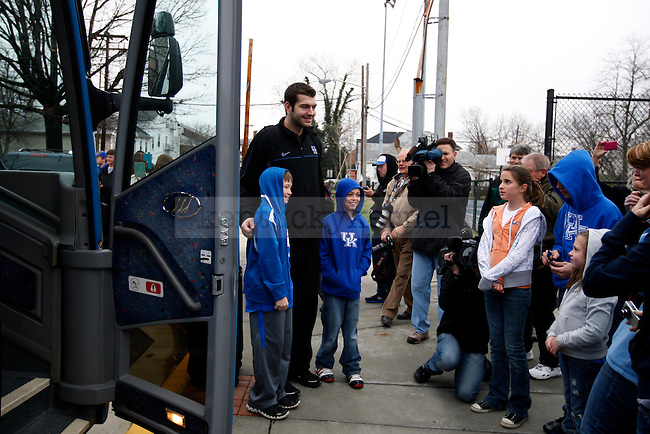 Josh Harrellson takes pictures with fans before the UK men's basketball team loads up on the bus to head to the airport and on to Houston, TX for the Final Four on Wednesday, March 30, 2011.  Photo by Britney McIntosh | Staff