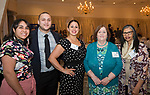 SOUTHINGTON, CT-050318JS11- Yamaris Lopez, left with her husband Tomas Olico with Catholic Charities; Sofia Swaby with the Salvation Army; Mary Conklin with Connecticut Legal Services and Laura Batista wit the Salvation Army, at the United Way of Greater Waterbury's 32nd annual Community Leaders Dinner and Awards event at the Aqua Turf in Southington. <br /> Jim Shannon Republican American