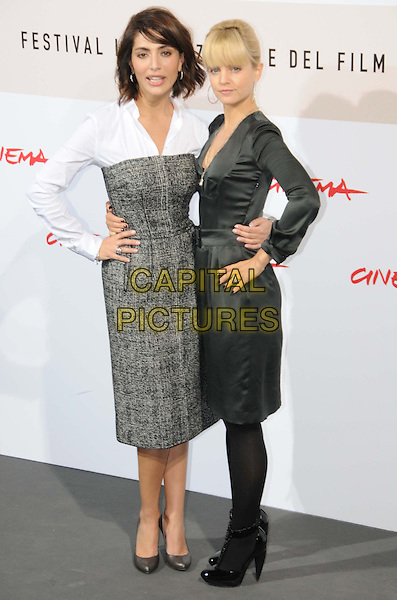 "CATERINA MURINO & MENA SUVARI.""The Garden of Eden"" Photocall during the 3rd Rome International Film Festival, Rome, Italy, 27 October 2008.full length grey gray dress white satin black hands on hips tights patent shoes .CAP/ADM/LIV.©Massimo Bruni/Liverani/Admedia/Capital PIctures"