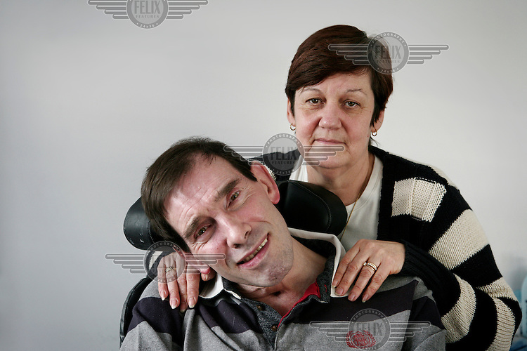 Jane Nicklinson looks after her husband Tony in Melksham, Wiltshire. Tony Nicklinson suffered from locked-in syndrome and died on 22 August 2012 after refusing food. The week before his death he lost a High Court case to allow doctors to end his life.