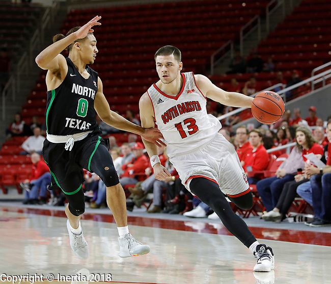 VERMILLION, SD: MARCH 14:  Matt Mooney #13 of South Dakota drives on Ryan Woolridge #0 of North Texas during the 2018 CBI Basketball Tournament at the Sanford Coyote Sports Center in Vermillion, S.D.  (Photo by DIck Carlson/Inertia)