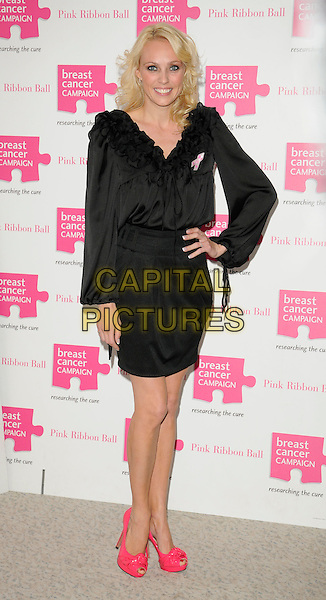 CAMILLA DALLERUP .Attending the Pink Ribbon Ball at the Dorchester Hotel, Park Lane, London, England, UK, October 10th 2009..full length  black dress pink shoes ruffles ruffle peep toe hand on hip skirt blouse top tucked in .CAP/CAN.©Can Nguyen/Capital Pictures.