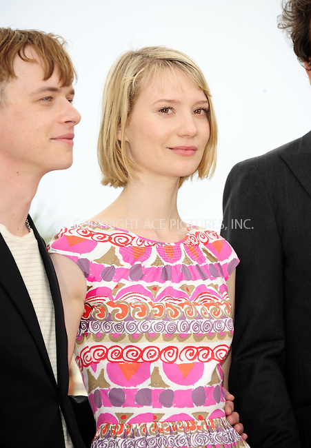 """WWW.ACEPIXS.COM . . . . .  ..... . . . . US SALES ONLY . . . . .....May 19 2012, Cannes....Dane Dehaan and Mia Wasikowska at the photocall for """"Lawless"""" at the Cannes Film Festival May 19 2012 in France ....Please byline: FAMOUS-ACE PICTURES... . . . .  ....Ace Pictures, Inc:  ..Tel: (212) 243-8787..e-mail: info@acepixs.com..web: http://www.acepixs.com"""