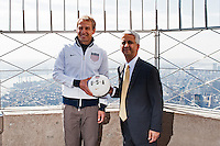 U.S. men's head coach Jurgen Klinsmann and U.S. Soccer president Sunil Gulati pose for a photo on the observation deck after flipping the switch to light the Empire State Building in the Red White and Blue colors of the US Soccer Federation during the centennial celebration of U. S. Soccer in New York, NY, on April 05, 2013.