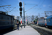 Bucharest, Romania. Gara de Nord railway station; electric locomotives, guard on platform.