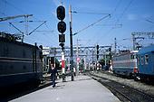 Bucharest, Romania. Gara de Nord railway station; electric locomotives, guard on platform.
