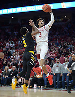 NWA Democrat-Gazette/ANDY SHUPE<br /> Arkansas guard Desi Sills (3) reaches to score Saturday, Nov. 30, 2019, as he is fouled by Northern Kentucky Bryson Langdon during the first half of play in Bud Walton Arena. Visit nwadg.com/photos to see more photographs from the game.