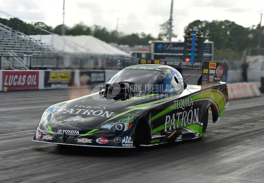 Jan. 16, 2013; Jupiter, FL, USA: NHRA funny car driver Alexis DeJoria during testing at the PRO Winter Warmup at Palm Beach International Raceway.  Mandatory Credit: Mark J. Rebilas-