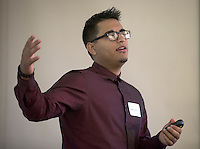 """Adan Cortez '16 presents """"The Impact of wellness workshops on the physical activity knowledge and behavior of the Occidental hourly staff."""" After researching all summer, Occidental College students present their work at the annual Summer Undergraduate Research Conference on July 29, 2015.<br /> (Photo by Marc Campos, Occidental College Photographer)"""
