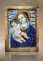 Pottery glazed plaque depicting the Virgin and Child made in Faenza, Italy, around 1500. inv 3100, The Louvre Museum, Paris.