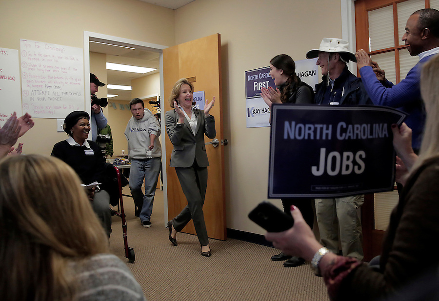 CORNELIUS, NC - NOVEMBER 1:  North Carolina Democratic incumbent for U.S. Senate Kay Hagan enters the room and energizes volunteers at her campaign office in Cornelius, NC, on Saturday, November 1, 2014.  Volunteers were preparing to canvass for votes just 3 days ahead of the election where Hagan faces Thom Tillis.  (Photo by Ted Richardson/For The Washington Post)