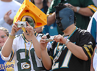 A decked out Jacksonville Jaguars fan and Green Bay Packers fan snap souvenir photos during pre-game introductions at Jacksonville Municipal Stadium in Jacksonville, Fl. (The Florida Times-Union, Rick Wilson)