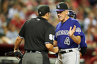 Colorado Rockies manager Jim Tracy #4 argues a call with umpire Mark Ripperger during a National League regular season game against the Arizona Diamondbacks at Chase Field on October 3, 2012 in Phoenix, Arizona. Colorado defeated Arizona 2-1. (Mike Janes/Four Seam Images)