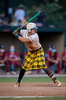 Savannah Bananas Gabe Howell (6) bats during a Coastal Plain League game against the Macon Bacon on July 15, 2020 at Grayson Stadium in Savannah, Georgia.  Savannah wore kilts for their St. Patrick's Day in July promotion.  (Mike Janes/Four Seam Images)
