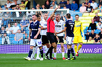 Jed Wallace of Millwall is shown a yellow card by Todays match referee Graham Scott during the Sky Bet Championship match between Millwall and Swansea City at The Den in London, England. September 1, 2018