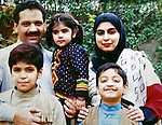 23 August 2011, Rawalpindi, Pakistan: A family picture of Amina Massod Janjua, 47, Chairperson of 'Defense of Human Rights, Pakistan' with husband Massod and children, Muhammad, Aishah and Ali. Her husband, Massod, went missing from a bus to Peshawar in 2006, believed to be detained by Pakistani security agencies. Amina has since worked tirelessly in the hope of havinhig him freed but has no idea whether he is even still alive. Picture by Graham Crouch for The Australian Magazine.
