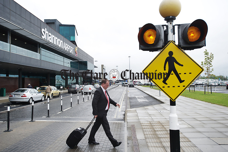 A passenger exits Shannon Terminal building on Wednesday afternoon. Photograph  by John Kelly.